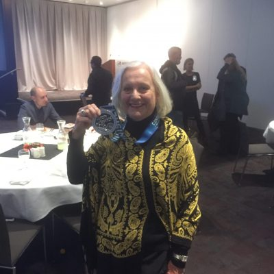 West Coast Installation Dinner. Jane Ryan, member of The Walking Club, with her 2017 LA Marathon medal.
